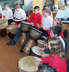 Teaching children to play African drums